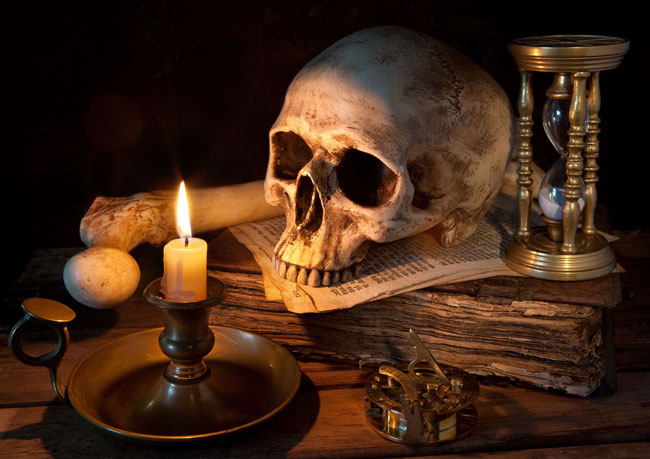 A skull and a candle.